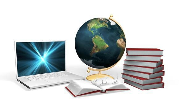 Clipart Illustration of a Laptop Computer With A Globe, Books And Pair Of Glasses